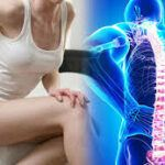 Woman Bent Over With Back Pain